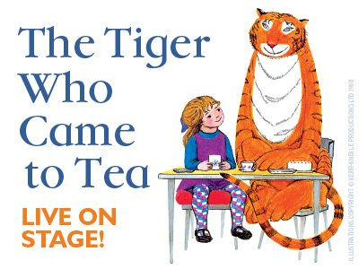 An illustration from The Tiger Who Came to Tea showing a little girl sitting next to an enormous tiger, they are sitting next to a table set for tea.