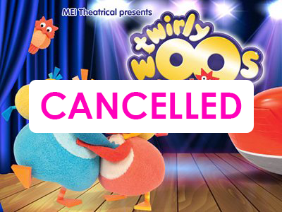 4 characters from the Twirlywoos TV show on a stage with blue curtains