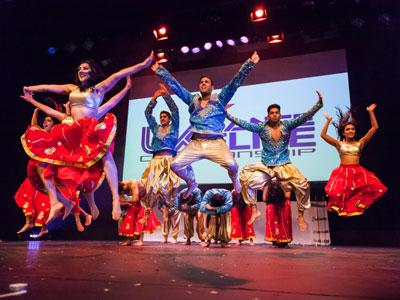 A photo of a group of Bollywood dancers performing on stage.