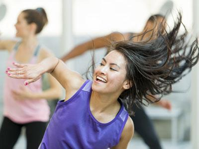 A young dancer smiling and flipping her hair