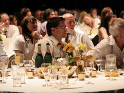 Guests sitting at a banqueting table