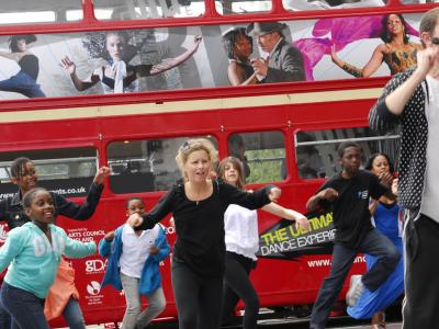 Image of artsdepot Youth Dance Company performing outside the Big Dance bus