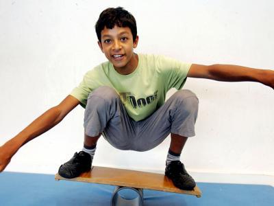Street Circus participant balancing on a board